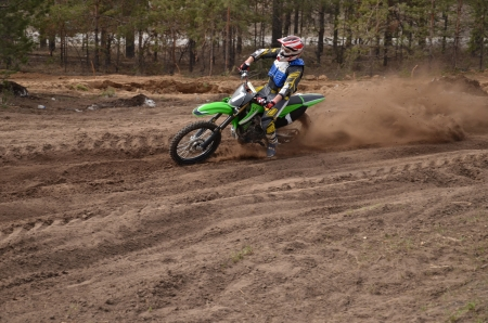 turnabout: MX rider inclination the bike turns point-blank of sand Stock Photo