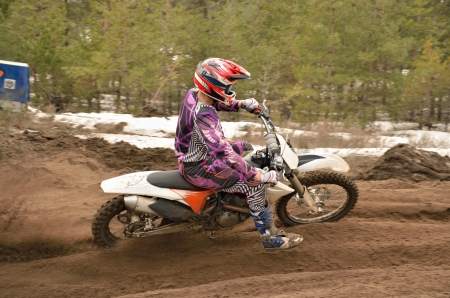 Motocross racer leaves the deep sandy ruts, motocross workout photo