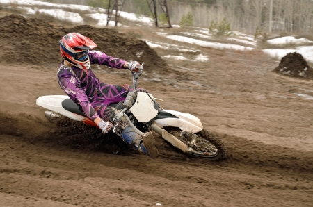 Motocross rider inclination the bike turns point-blank of sand Stock Photo