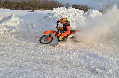 turnabout: Motocross winter turn with emphasis in a snowdrift racer and motorcycle