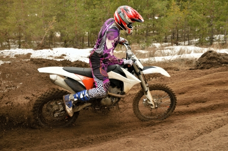 turnabout: racer off the corner on the sandy motocross track Stock Photo