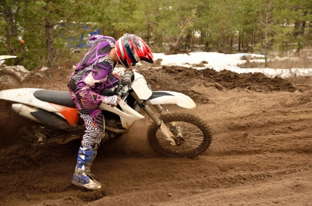 rider bogged down in a deep rut with a large slope of the motorcycle Stock Photo