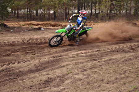 mx: MX rider inclination the bike turns point-blank of sand Stock Photo