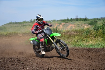 X games MX racer on a motorbike acceleration out bend on track motocross