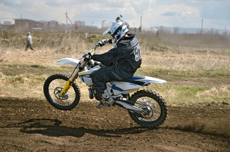 turnabout: MX racer on a motorbike acceleration out bend on track motocross Stock Photo