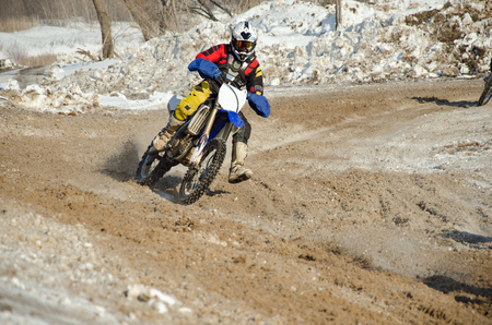 Motocross rider on the motorcycle accelerates from turning