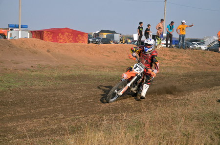 turnabout: RUSSIA, SAMARA - SEPTEMBER 26: The rider V. Panfilov on the motorcycle is accelerating cornering of the track, Regional Motocross Championship on September 26, 2015 in Samara, Russia Editorial