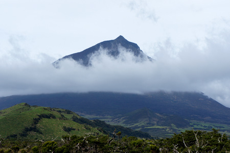 Faraway volcano Pico.Azores Island. Stock Photo