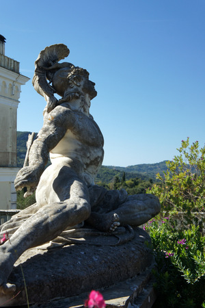 Corfu Island.Darkened from time marble statue of Achilles.