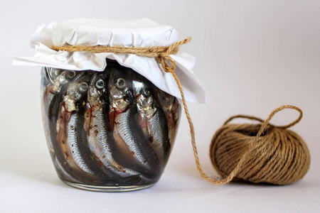 marinated anchovies in a glass jar Stockfoto