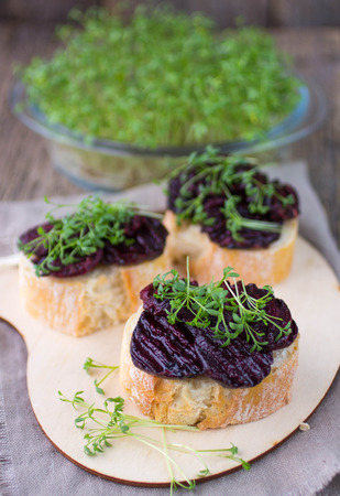water cress: Bruschetta with roasted beet and watercress salad Stock Photo