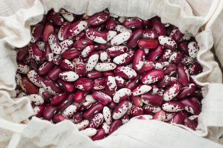 linen bag: Dry mottled beans in a linen bag on the table