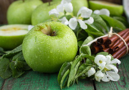 green apples: Green apples, mint and cinnamon on wooden table Stock Photo