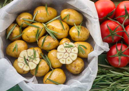 broil: Potatoes for roasting with rosemary, garlic, olive oil and coarse sea salt Stock Photo