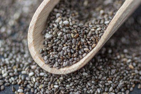 Organic Dry Chia Seeds -  a rich source of omega-3 fatty acids. Background of Chia seeds . Top view. Selective focus