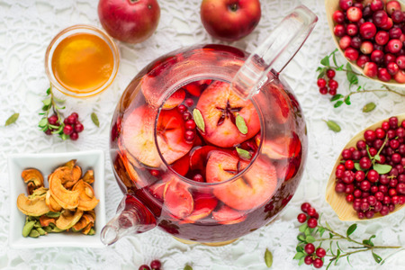 warm drink: Fruit tea from apples, cranberries, cowberry  and cardamom. Hot Christmas drink