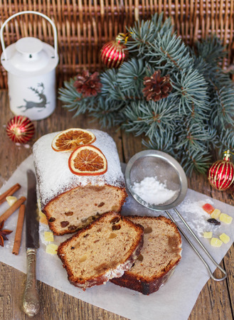 fruitcake: Fruitcake with nuts, raisins, candied fruit and spices. Traditional Spicy Christmas cake. Soft focus
