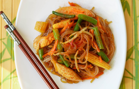 soy sprouts: Spicy glass noodles with chicken, green beans, carrots, corn and soy sprouts. Oriental cuisine