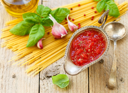 pasta sauce: Homemade tomato sauce for pasta and meat from fresh tomatoes with garlic, Basil and spices. Selective focus Stock Photo