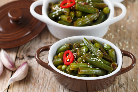 oriental cuisine: Spicy green beans and peas with spices in portion pots. Oriental cuisine Stock Photo