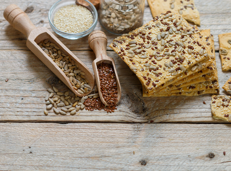 sesame cracker: Crispy cookies made from whole wheat flour with flax seed, sunflower seeds and sesame seeds. copy space Stock Photo