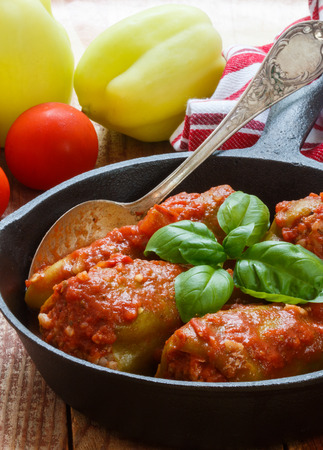Bulgarian peppers stuffed with meat and rice with tomato sauce. Selective focus Stock Photo