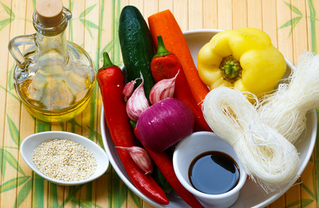 oriental cuisine: Ingredients for making spicy glass noodles with vegetables - carrots, cucumber, peppers, garlic. Asian and Oriental cuisine. Selective focus