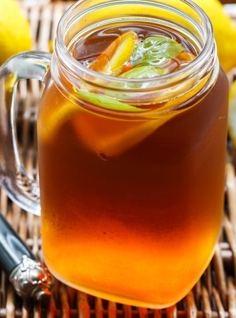 Summer refreshing drink. Citrus ice tea. Selective focus