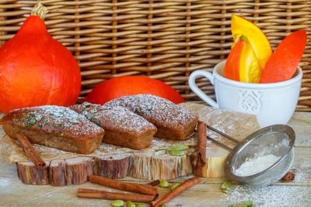 financier: Homemade pumpkin financier cake with cinnamon and cardamom. Autumn spiced cakes. A rustic style. Selective focus