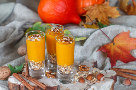 Pumpkin smoothies with cinnamon, ginger and granola. Useful nutrition. Autumn desserts. Selective focus Stock Photo - 63138016