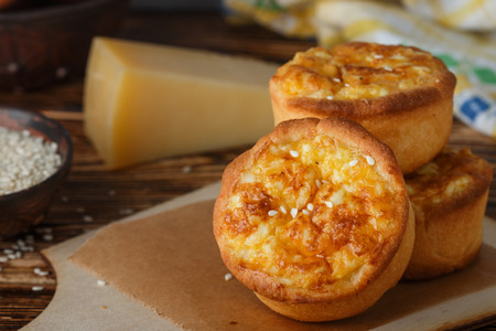 scrool: Mini pies with cheese, onion and egg. Tartlets. Delicious snack for gourmands. Selective focus