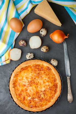 puff: Homemade gourmet pie with cheese, onions and eggs. Selective focus