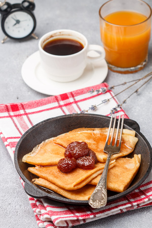 Breakfast. Crepes. Thin pancakes with strawberry jam. Selective focus Foto de archivo