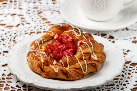 Delicious cake of puff pastry with raspberries, custard, almond and white chocolate. Dessert, gourmet