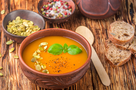 Delicious homemade pumpkin soup with spices and Basil. Vegetarian diet nutrition. Selective focus Stock Photo