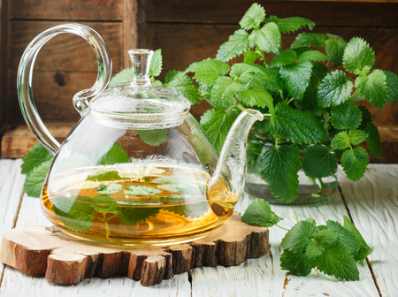 Herbal tea with Melissa and mint on the table in a transparent teapot. Selective focus Stockfoto