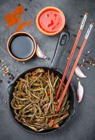fiddlehead: Spicy salad of fern with onion, garlic, soy sauce and spices. Dish Eastern and Asian cuisine. Selective focus