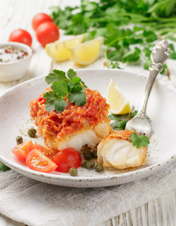 White fish (cod, Pollock, nototenia, hake), braised with onions, carrots and tomatoes. Vegetable marinade. Delicious hot or cold snacks for foodies. Selective focus