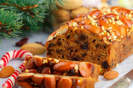Fruitcake. Traditional Christmas cake with almonds, dried cranberries, cinnamon, cardamom, anise, cloves.