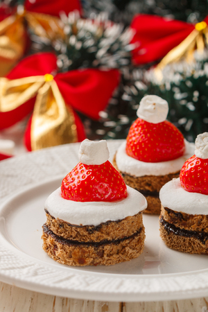 Christmas dessert of gingerbread, marshmallow, strawberry and chocolate sauce. New year. Selective focus