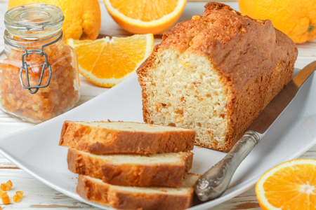 Homemade orange fruit loaf cake with citrus candied fruits and nuts.  Traditional treat for tea for Breakfast. Pound cake. Selective focus Stock Photo