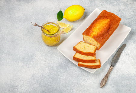 Homemade pound cake with lemon and jam. Traditional treat for tea. Citrus loaf cake. Selective focus, copy space