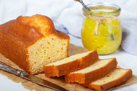 Homemade pound cake with lemon and jam. Traditional treat for tea. Citrus loaf cake. Selective focus Stock Photo