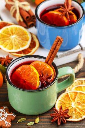 Mulled wine. Traditional hot winter alcoholic or non-alcoholic drink of red wine, citrus fruits (orange or Mandarin) with cinnamon, honey, cardamom, ginger and star anise. Punch. Grog. Christmas. New Year. Selective focus