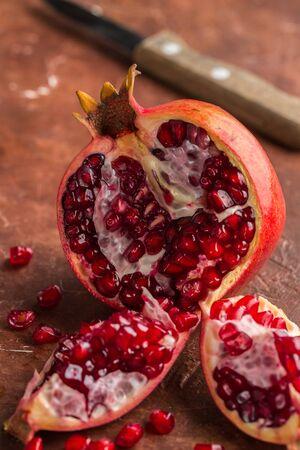 Ripe juicy organic cut pomegranate on a dark background. Fresh fruit. Vitamins. Healthy diet. Selective focus 스톡 콘텐츠 - 140993501