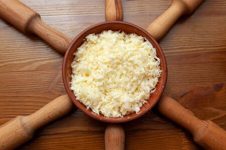 Grated cheese and rolling pins on the table