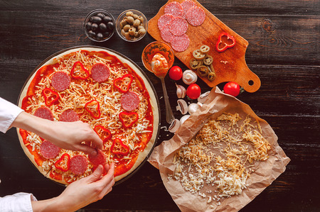 pizza base: Raw pizza ingredients on wooden table