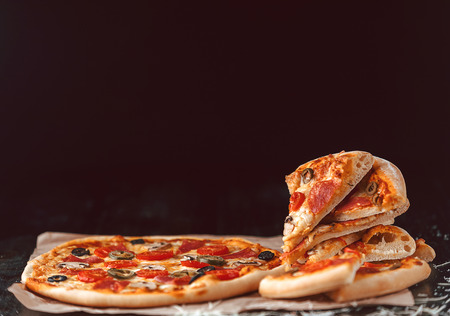 Hot Homemade Pepperoni Pizza Ready to Eat. natural light Stock Photo