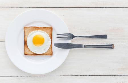 sunny side up: fried egg on toast Stock Photo