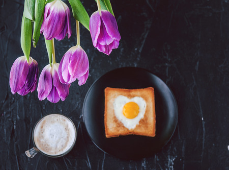 loved: Still breakfast for a loved one with tulips on a dark background
